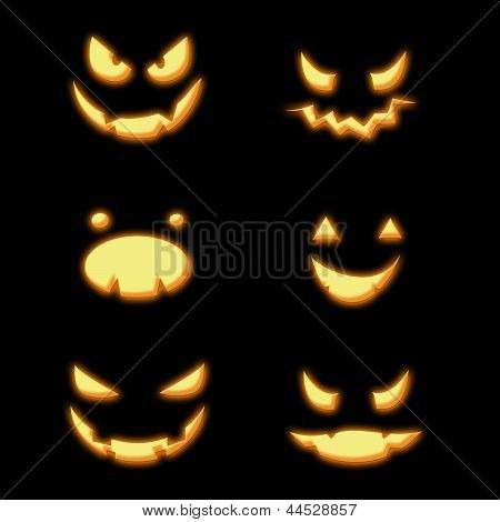 Halloween pumpkin spooky faces in the dark