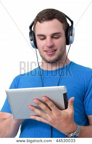 Young Man With Headphones Working On A Tablet Pc