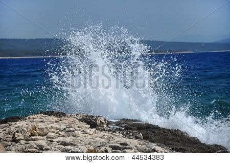 High wave breaking on the rocks of the coastline