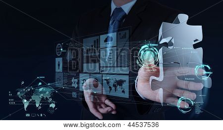 Businessman Hand Working With Computer Interface Show Puzzles