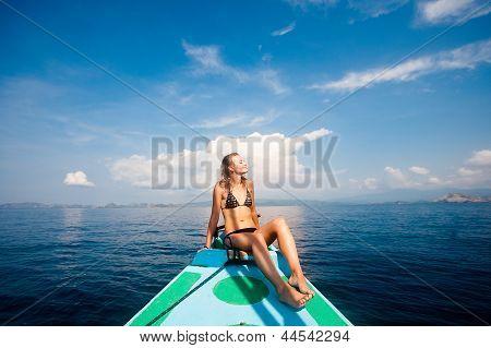 Young sexy woman in bikini enjoying the sun