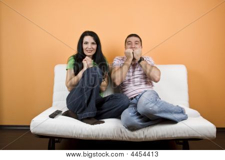 Couple Watching Tv  A Scary Movie