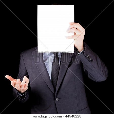 Businessman Holding  An Empty Sheet Of Paper In Front Of His Face