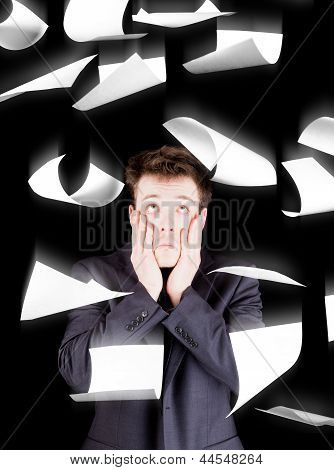 Despaired Businessman With Paperwork Falling Everywhere