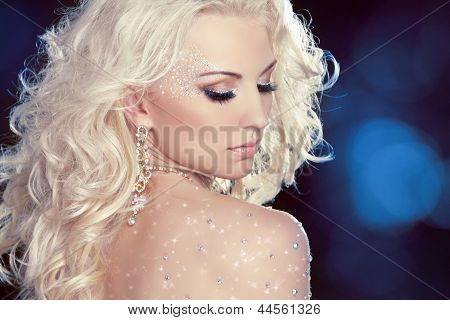 Glamour Portrait Of Beautiful Woman Model With Fashion Makeup And Romantic Wavy Hairstyle Over Night