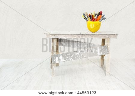 Construction Grunge Ladder And Helmet Full With Tools In White Interior. House Improvement Concept