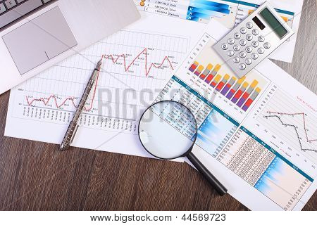 Businessman workplace with papers