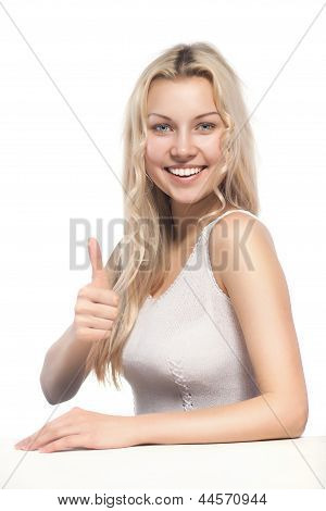 attractive blonde woman showing thumbsup