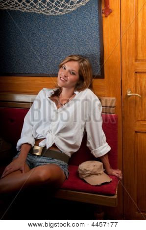 Fashion Model Sitting In Wooden Interior