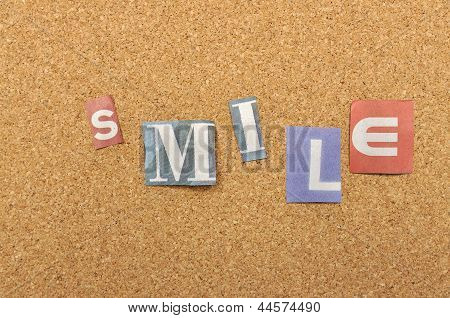 Smile Word Made From Newspaper Letter