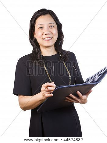 Mature Asian Woman In Business Attire With Note Pad And Glasses On White Background