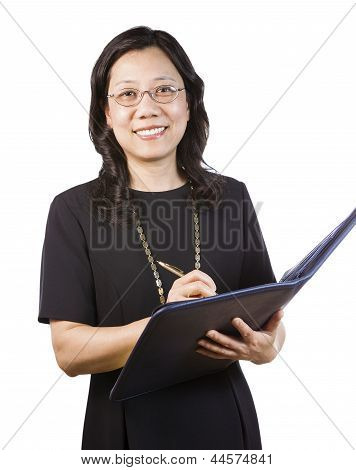 Mature Asian Woman In Business Attire With Writing Tools