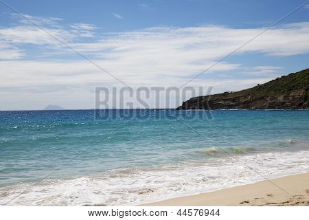 Saline beach at St. Barths, French West Indies with the view at the islands  of St. Eustatius and Sa