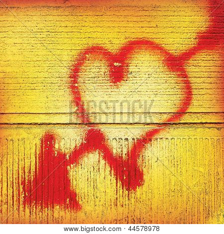 Heart With An Arrow Painted In Red On A Background Of Old Concrete Wall