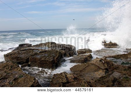 Waves Crashing On A Rocky Beach In Australia