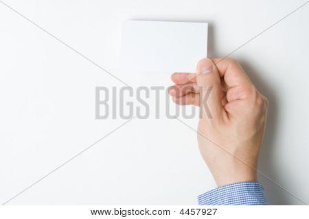 Man presenting Visitenkarte