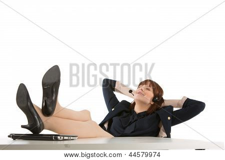 Businesswoman Relaxing On The Job