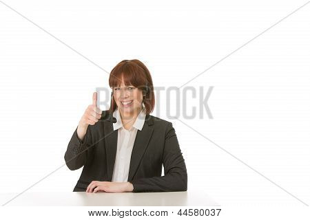 Happy Woman Wearing A Headset Giving Thumbs Up