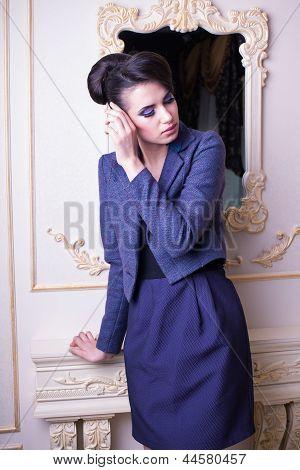 Elegant Girl Posing Over Classic Background