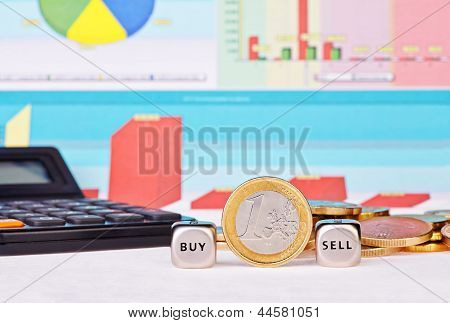 Dices Cubes With The Words  Sell, Buy One-euro Coin, Calculator  And Financial Diagrams As Backgroun