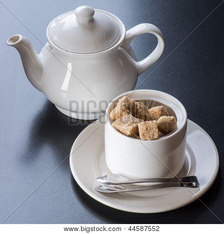white tiapot with sugar bowl