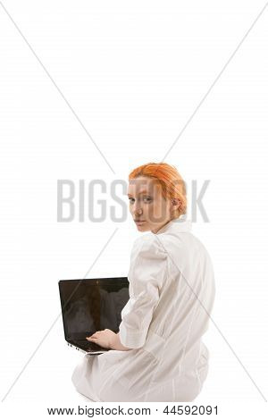Young Redhead Woman Using A Laptop