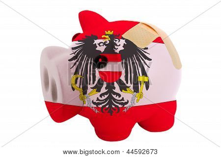 Closed Piggy Rich Bank With Bandage In Colors National Flag Of Austria