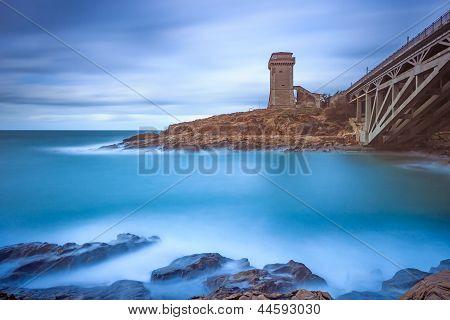 Calafuria Tower Landmark On Cliff Rock, Aurelia Bridge And Sea. Tuscany, Italy. Long Exposure Photog