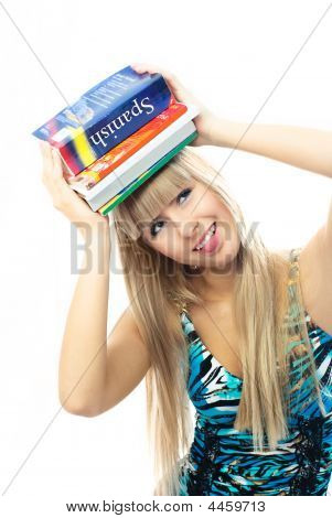 Blond Girl Holding A Lot Of Book On Her Head