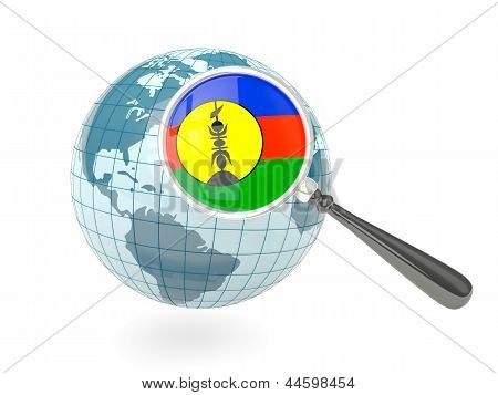 Magnified Flag Of New Caledonia With Blue Globe