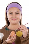 Adorable Girl Adorning Easter Eggs