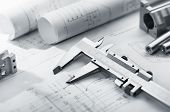 picture of mechanical drawing  - caliper and machine parts on mechanical blueprint - JPG