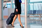 stock photo of flight attendant  - Unrecognizable business women with travel bag at airport
