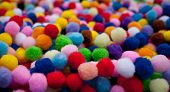 foto of pom poms  - Multicoloured pile of brightly coloured pom poms - JPG