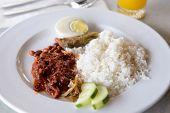 foto of nasi  - Traditional Malay famous and common food named Nasi Lemak  - JPG