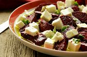 stock photo of beet  - salad of roasted red beets and feta cheese with olive oil - JPG