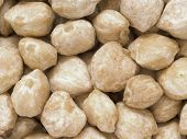 picture of kukui nut  - close up of white candlenuts food background - JPG