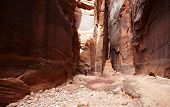 foto of buckskin  - A backpacker makes her way through the beautiful sandstone walls of Buckskin Gulch - JPG