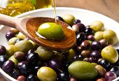 picture of virgin  - Extra virgin healthy Olive oil with fresh olives on rustic wooden background - JPG