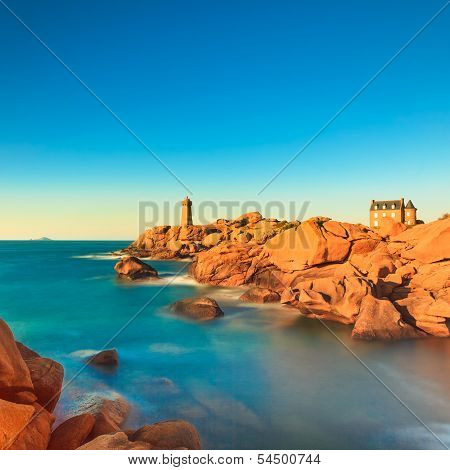 Ploumanach Lighthouse Sunset In Pink Granite Coast, Brittany, France.