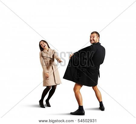 laughing woman pointing at man in open coat. isolated on white background