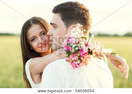 Just Married Couple Hugging And Smiling