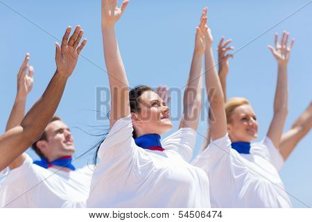 group of Christian church choir praising and worshiping outdoors