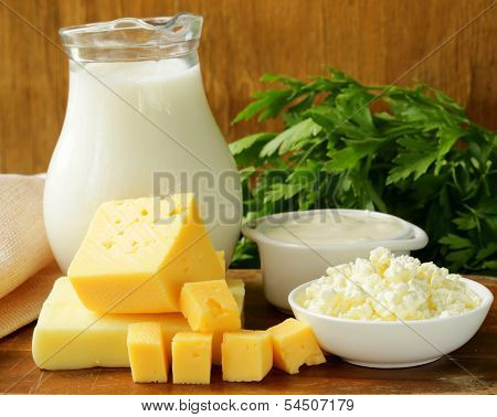 still life of dairy products (milk, sour cream, cheese, cottage cheese)