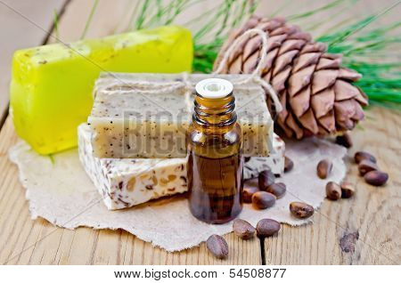 Oil And Soap Different With Cedar Nuts And Cone On A Board