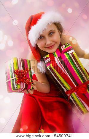 Christmas Gifts And Small Girl Santa