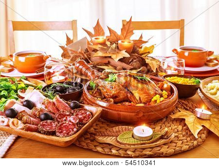 Festive Thanksgiving day dinner, celebration holiday at home, traditional homemade tasty dishes, beautiful autumnal decor