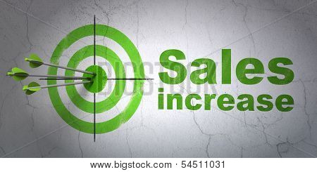 Marketing concept: target and Sales Increase on wall background