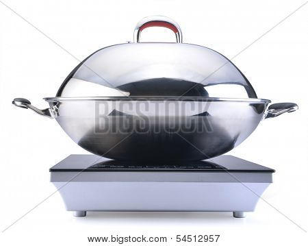 Wok at the induction stove over the white background