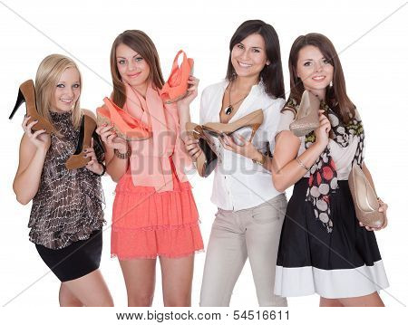 Four Fashionable Girls With Their Shoes